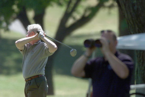 President Clinton working on his golf swing