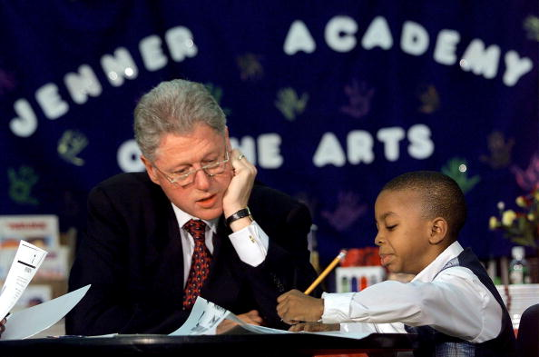 Bill Clinton helps tutor a student