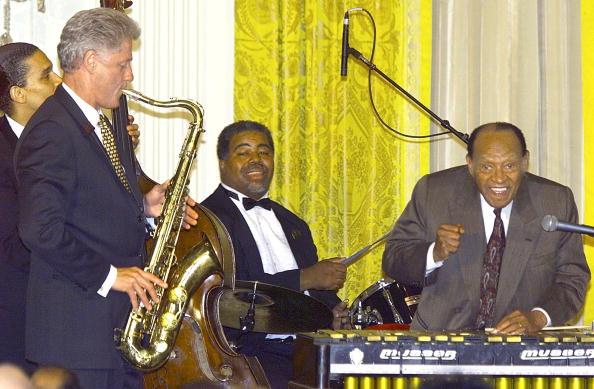 Bill Clinton plays the saxophone