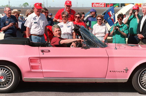 Bill Clinton in a Ford Mustang