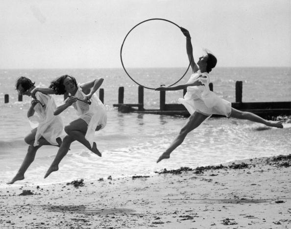 Three members of a dance school rehearse for an upcoming performance on the beach at Worthing.