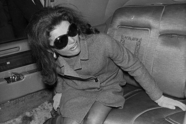 Jacqueline Onassis, formerly Kennedy, arriving at London Airport in the back of a car, November 14th 1968