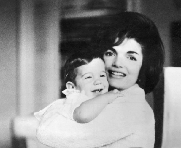 Jacqueline Kennedy holds John Jr.