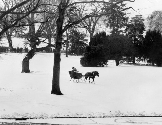 Jacqueline Kennedy takes a a sleigh ride with her children John F. Kennedy, Jr. and Caroline Kennedy