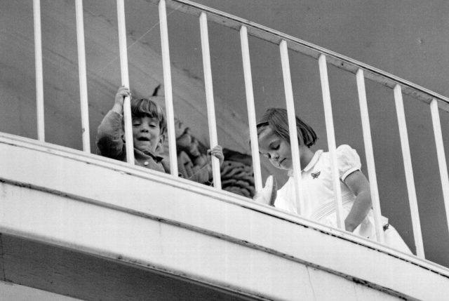 John F Kennedy Jr. and Caroline play on the South Portico of the White House