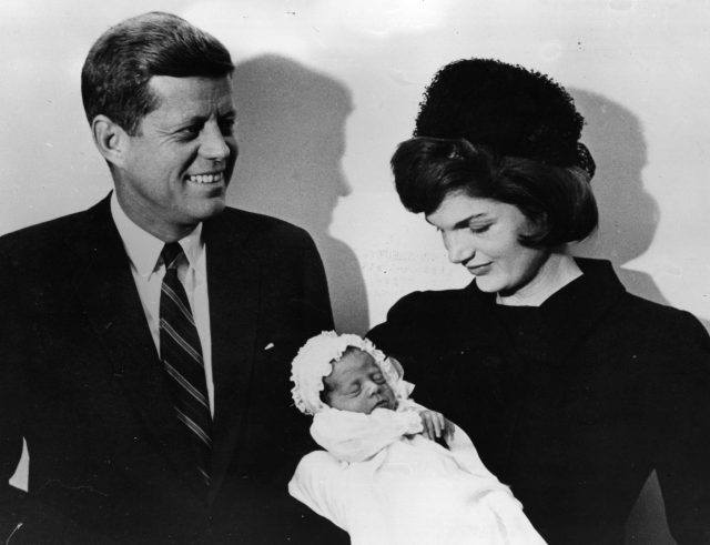 John F. Kennedy and Jacqueline Kennedy at the christening of their son John F Jr.