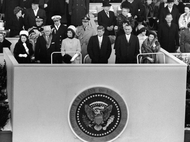 John F. Kennedy stands on a platform for his inauguration