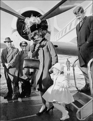 John Fitzgerald Kennedy, his wife Jacqueline, and their daughter Caroline arriving at an airport