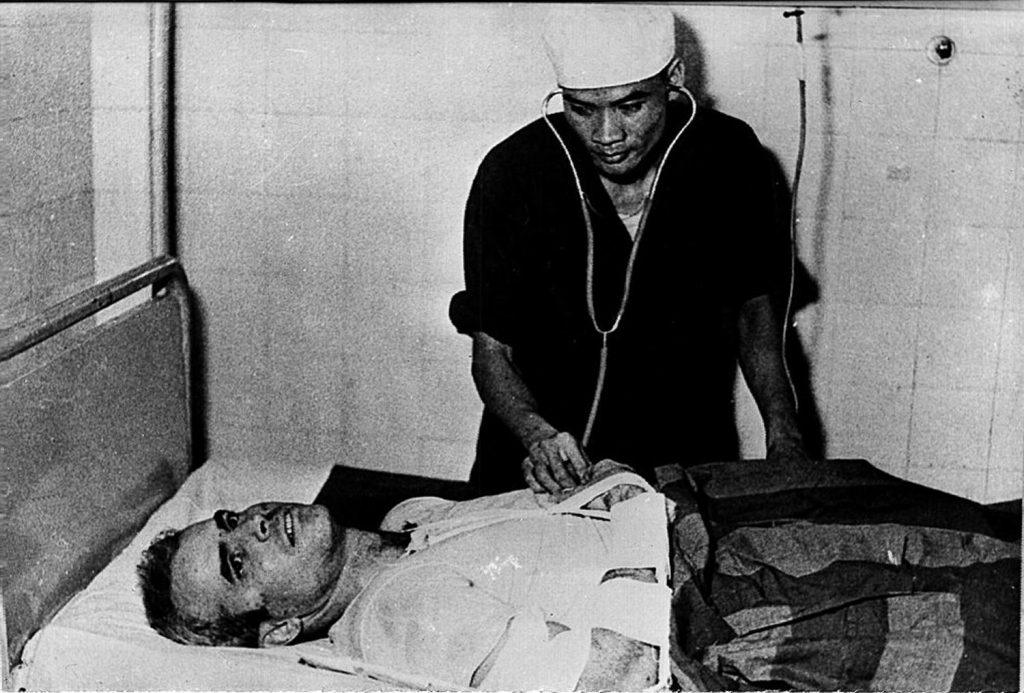 U.S. Navy Airforce Major John McCain being examined by a Vietnamese doctor