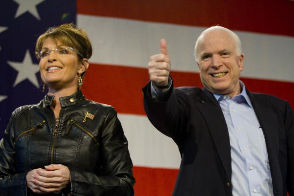 John McCain (R-AZ) and former Alaska Gov. Sarah Palin (L) attend a campaign rally at Pima County Fairgrounds on March 26, 2010