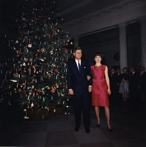 John and Jacqueline Kennedy attend a White House staff Christmas Party