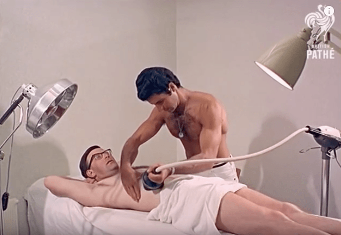 Man using the vibro massage machine for weight loss on his friend