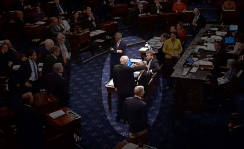 John McCain voting against the repeal of Obamacare