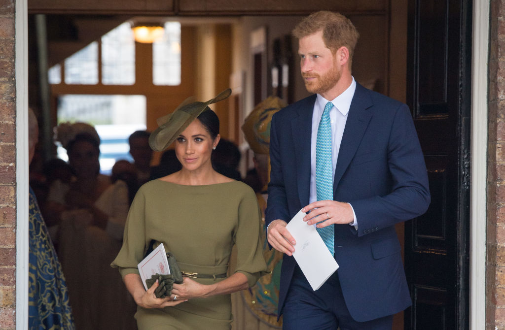 The Duke and Duchess of Sussex depart after attending the christening of Prince Louis at the Chapel Royal, St James's Palace on July 09, 2018 in London, England