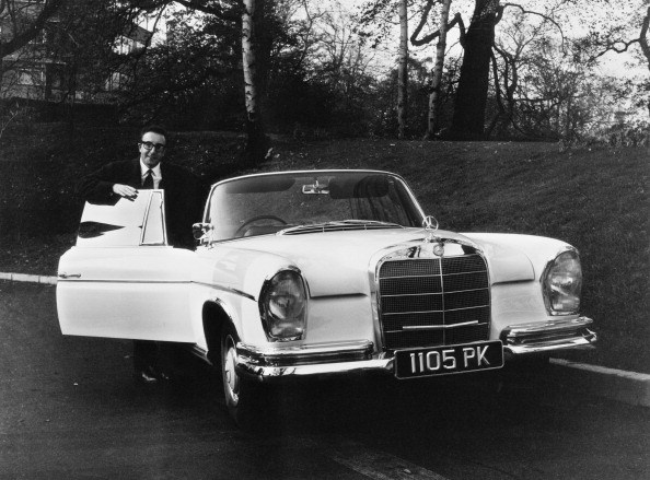 English comic actor Peter Sellers with his new Mercedes-Benz 300 SE Cabriolet (aka Mercedes-Benz W112), 7th November 1962.