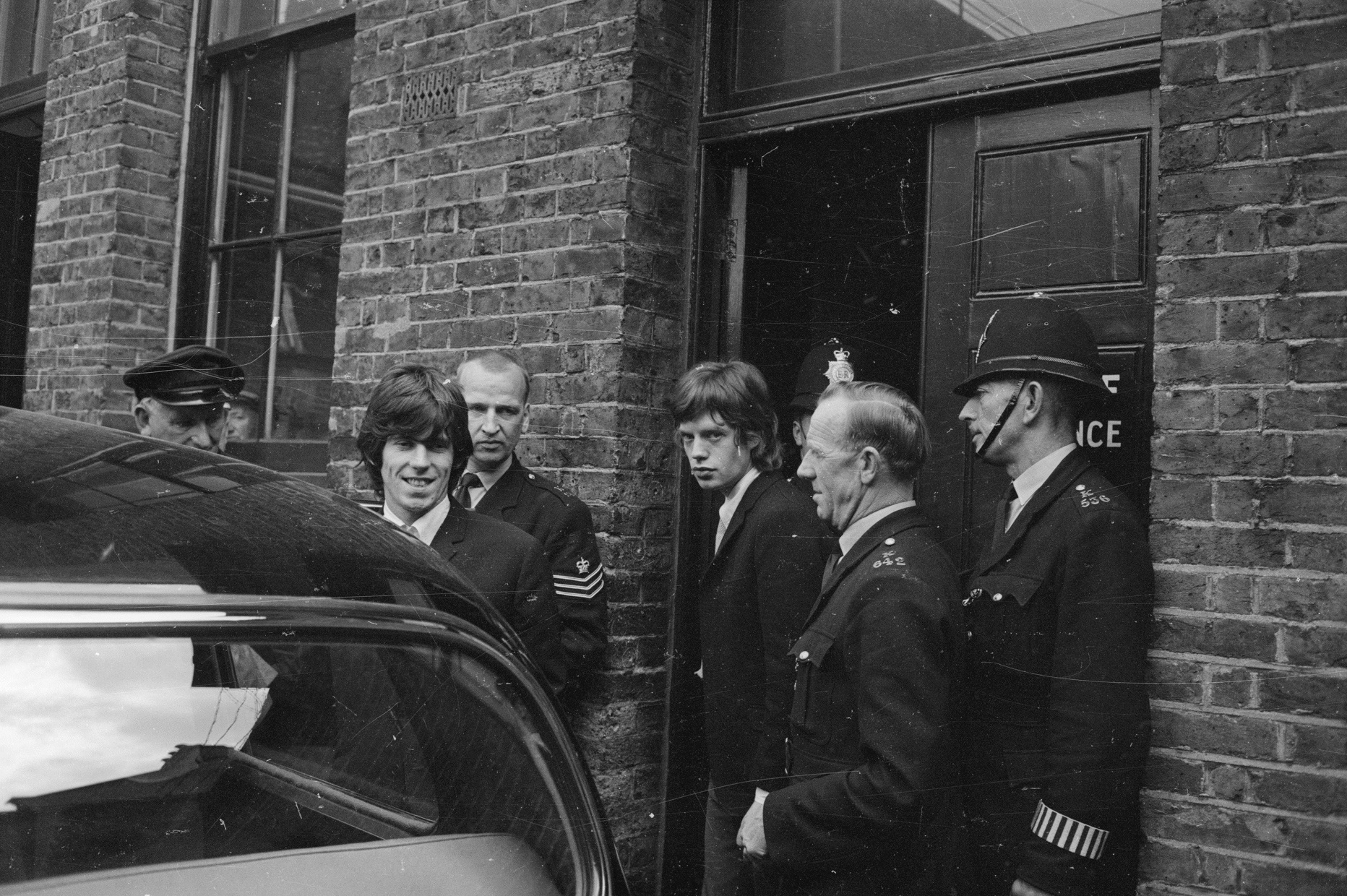 Mick Jagger and Keith Richards leaving jail in 1965