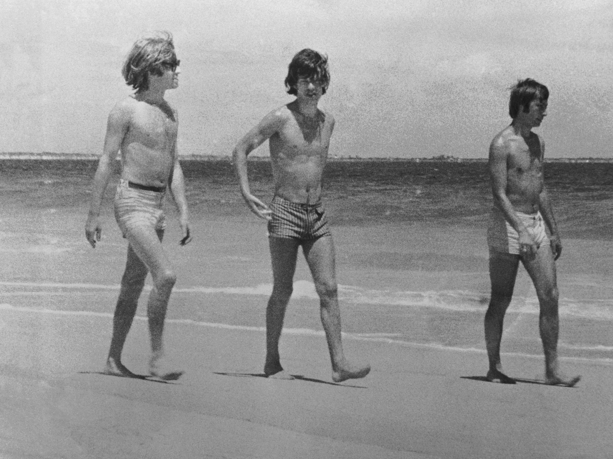 Rolling Stones Brian Jones, Mick Jagger and Charlie Watts on the beach in Australia, 1965