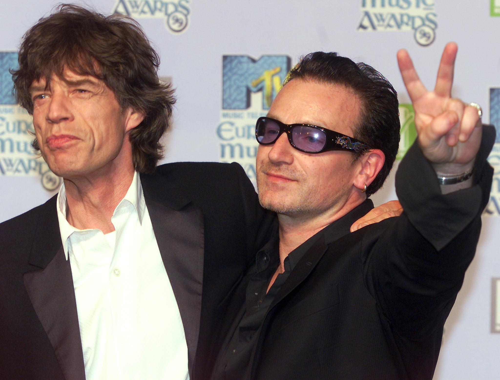 Mike Jagger (L) and Bono, the lead singer of Irish group U2 in 1999
