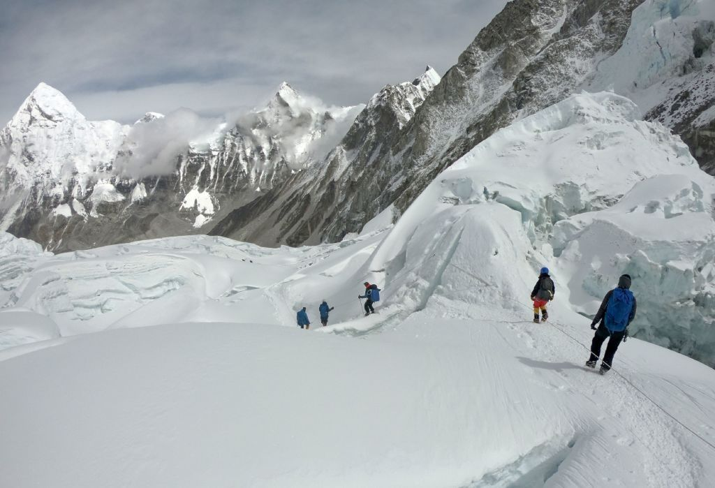 In this photo taken on April 29, 2018, mountaineers walk near camp one of Mount Everest