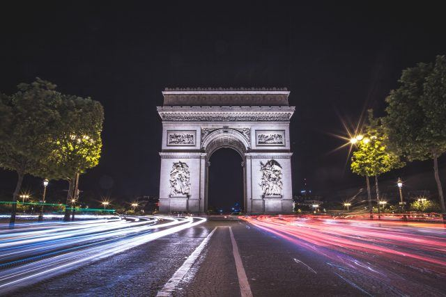 A long exposure photo centered on the famous Arc de Triomphe with traffic passing. 2017 Paris, France