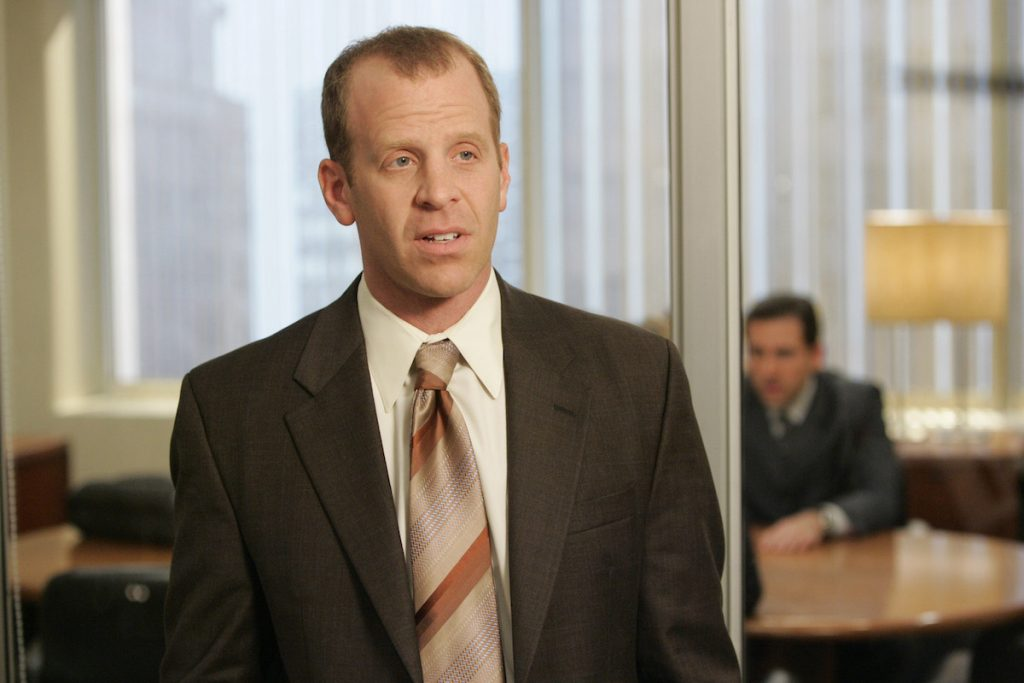 Actor Paul Lieberstein in character as Toby Flenderson with actor Steve Carell in character as Michael Scott in the background on set of 'The Office'