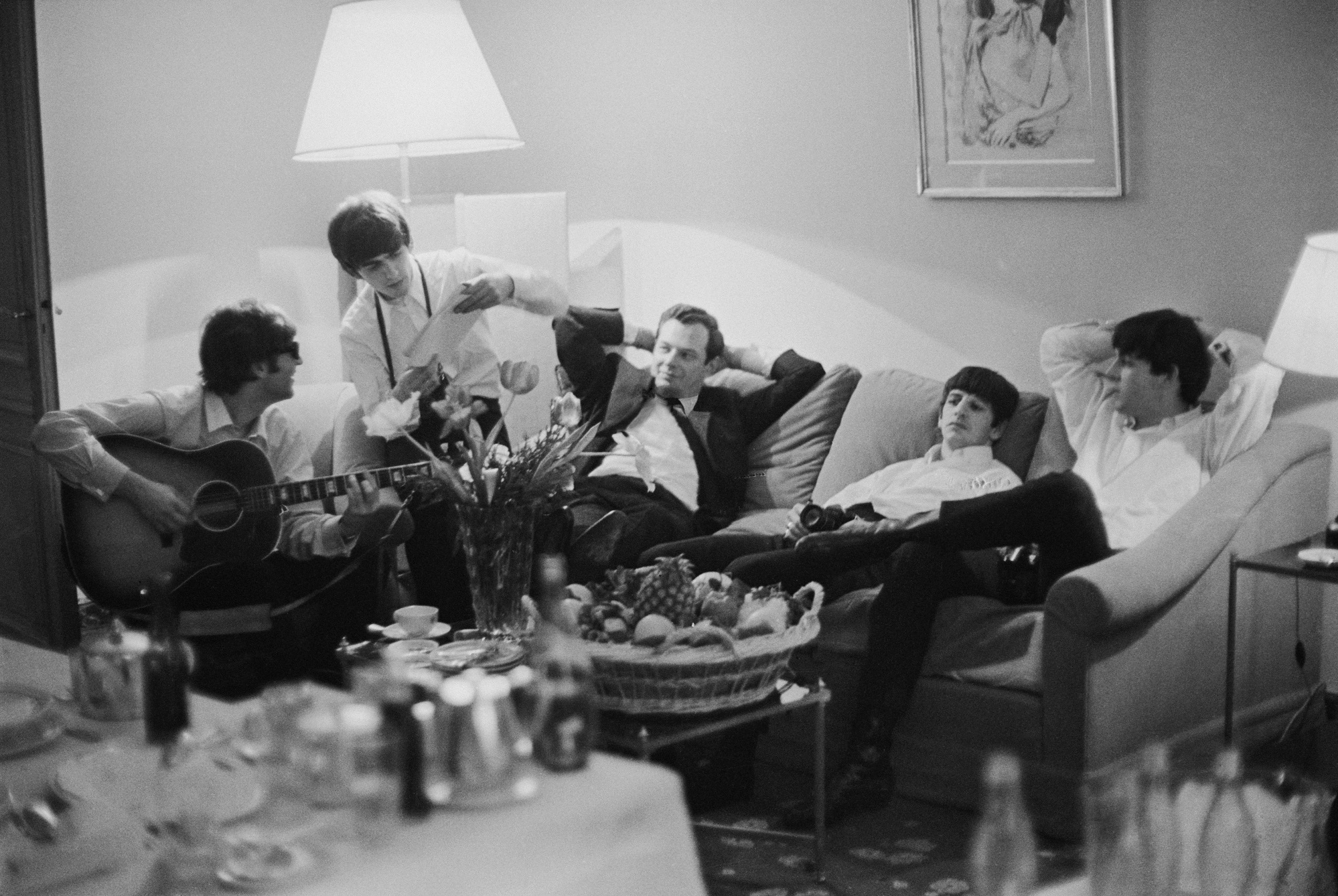 The Beatles relax in a hotel room in Paris, 16th January 1964.
