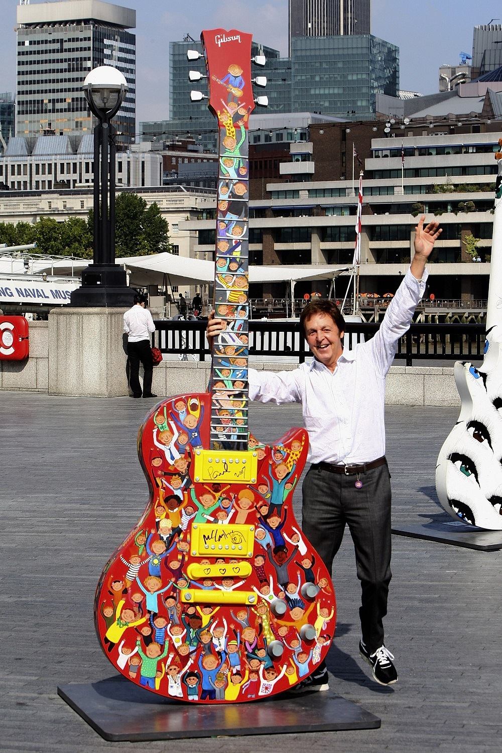 Sir Paul McCartney Signs his ten foot Gibson Les Paul sculpture at More London Riverside by City Hall on September 12, 2007