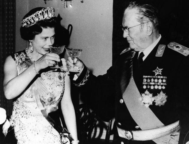 President Josip Broz Tito of Yugoslavia raises a glass to share a toast with Queen Elizabeth II