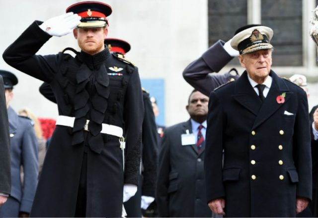Prince Harry and Prince Philip during their visit to the Field of Remembrance at Westminster Abbey in 2016