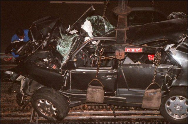 A French policeman attaches the wreckage of Princess Diana's car 3