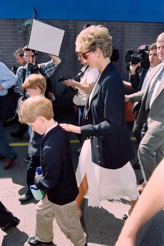 Princess Diana and Prince Harry arrive for the start of the British Grand Prix