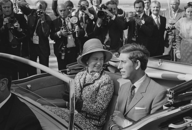 Queen Elizabeth II and Prince Charles travel in an open top car in Avignon