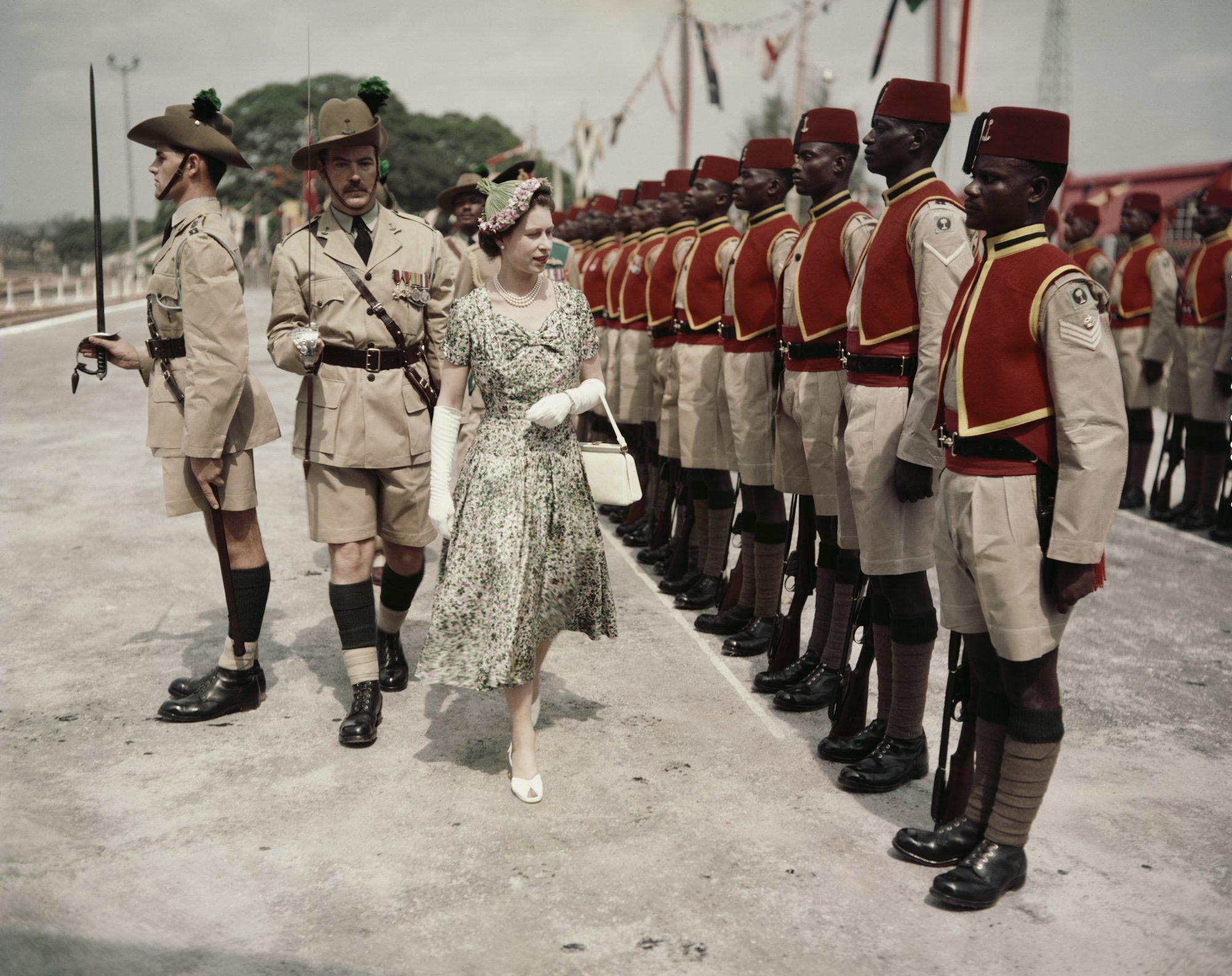 Queen Elizabeth II inspects men of the newly-renamed Queen's Own Nigeria Regiment, Royal West African Frontier Force, at Kaduna Airport, Nigeria
