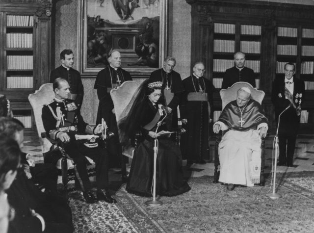 Queen Elizabeth II reads out a message to Pope John Paul II at the Vatican