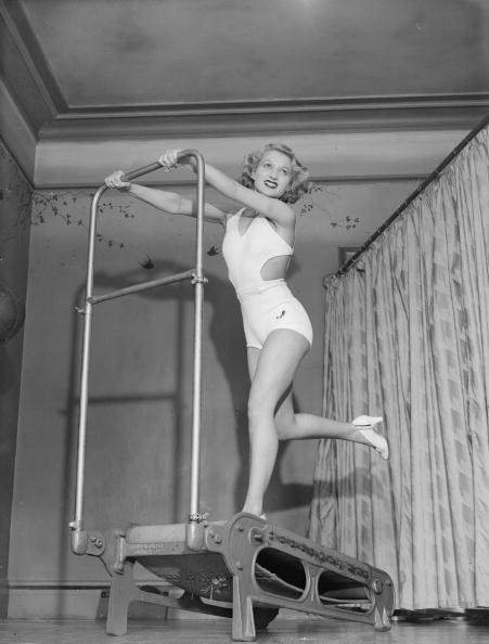 Rosemary Andree demonstrating how to use a treadmill in the '30s