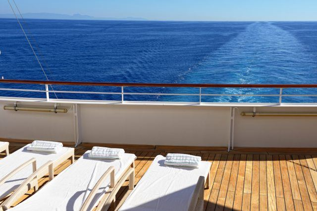 Row of lounge chairs on the deck of a cruise ship