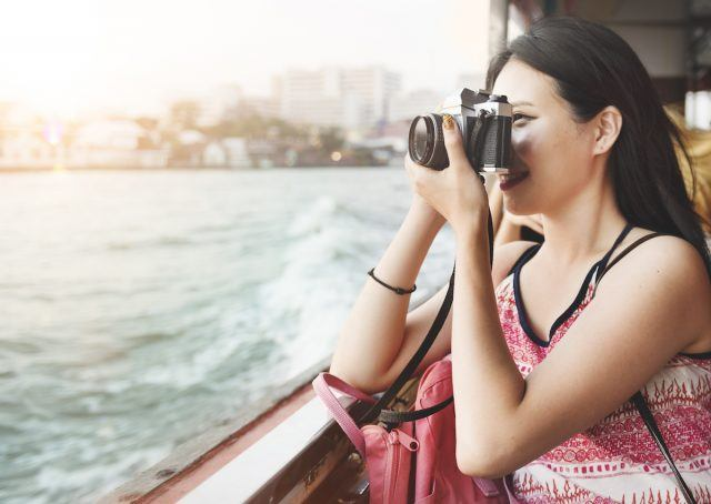 Ship passenger takes a photo with her camera