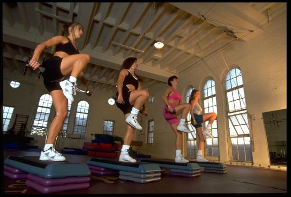 Women performing step aerobic