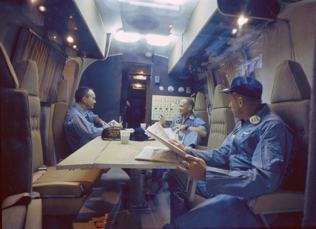 The Apollo 11 crew inside the mobile quarantine facility after their return to earth
