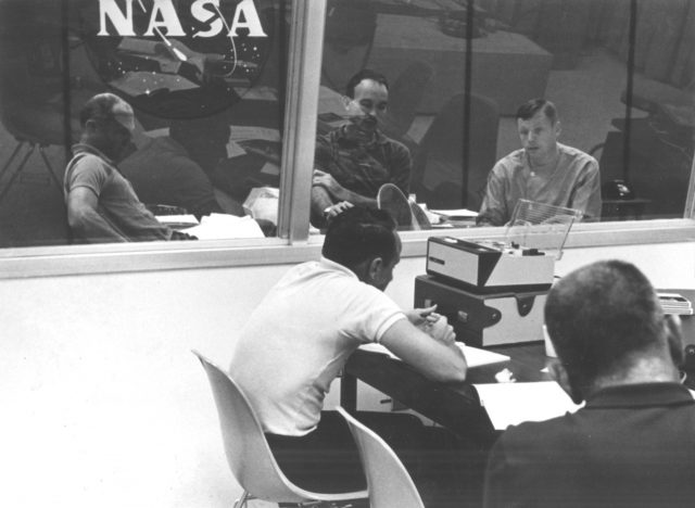 The Apollo 11 crew undergoes their first debriefing