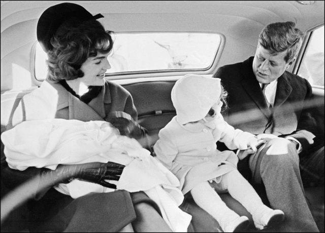 The Kennedy family sits in the presidential car