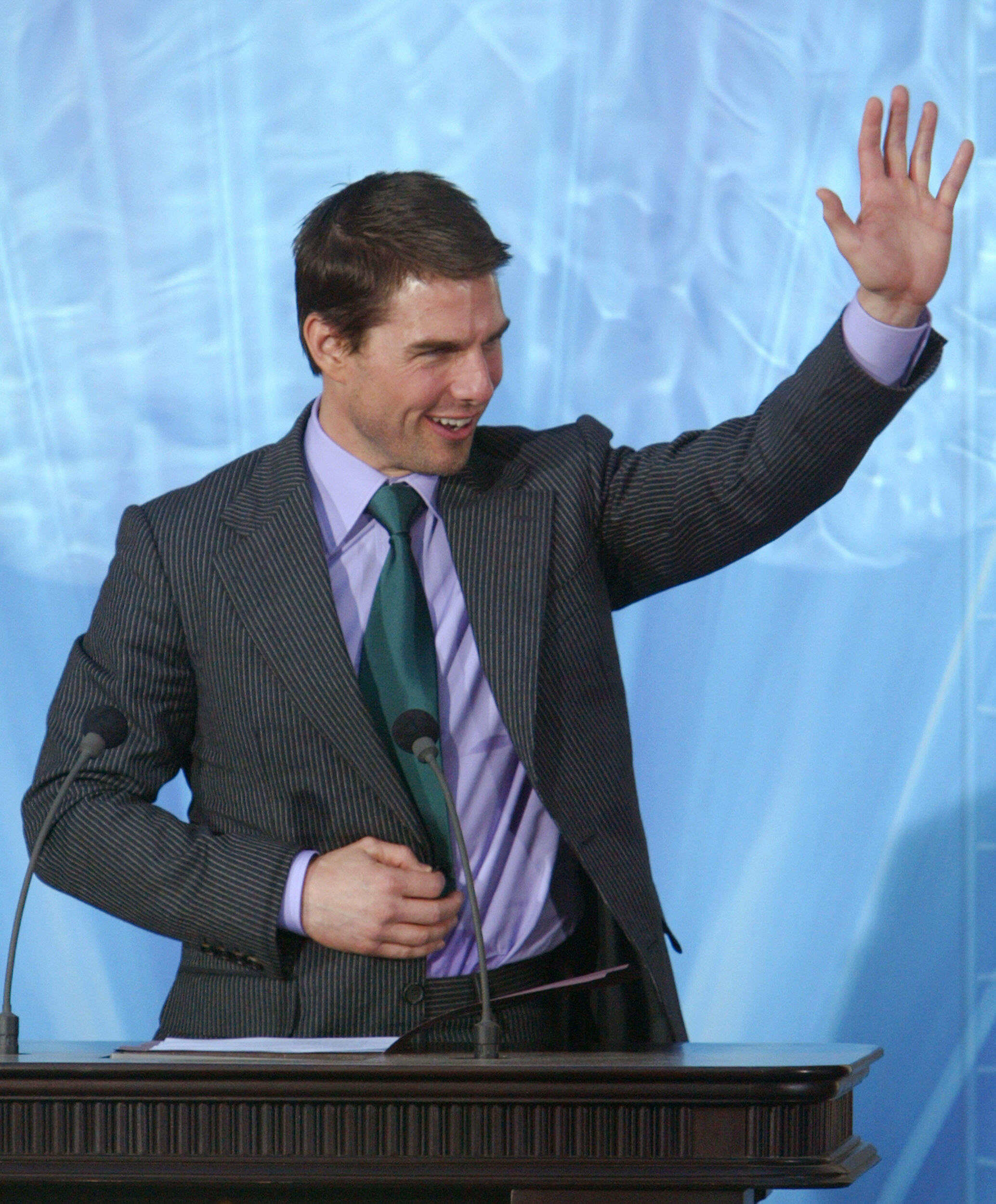 Tom Cruise waves during the inauguration of the Church of Scientology