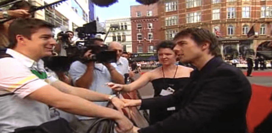 Tom Cruise with a reporter who squirted him with water