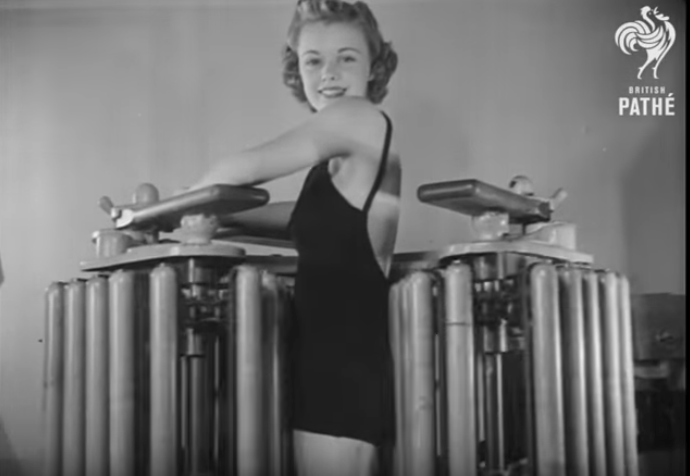 Woman using exercise equipment in the '40s