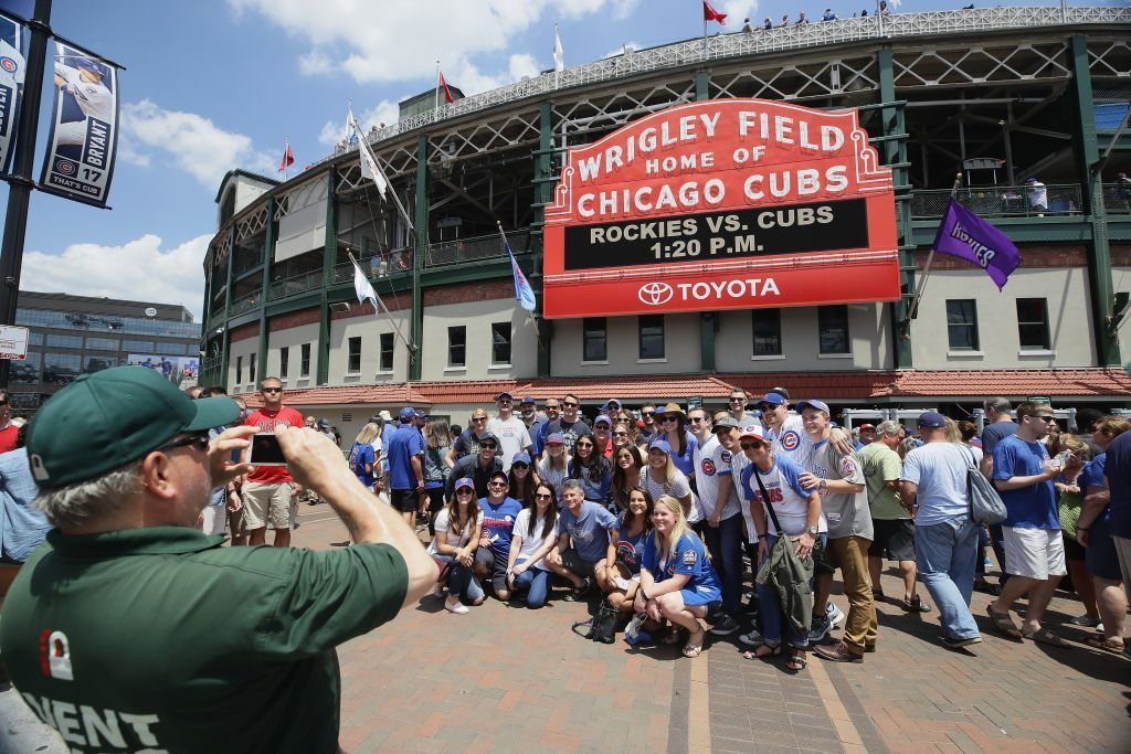Fans have their picture taken in front of the marquee at Wrigley Field