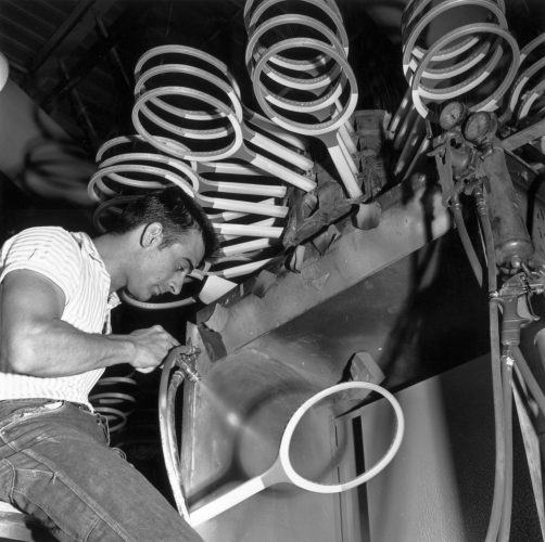A man at work in the Spalding tennis racquet factory