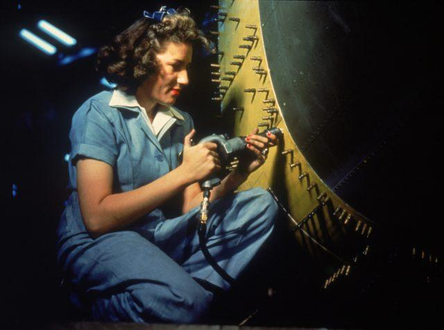 A riveter works on a bomber at at Consolidated Aircraft Corporation