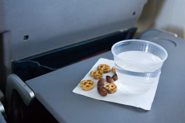 A snack of pretzels and nuts on a plane