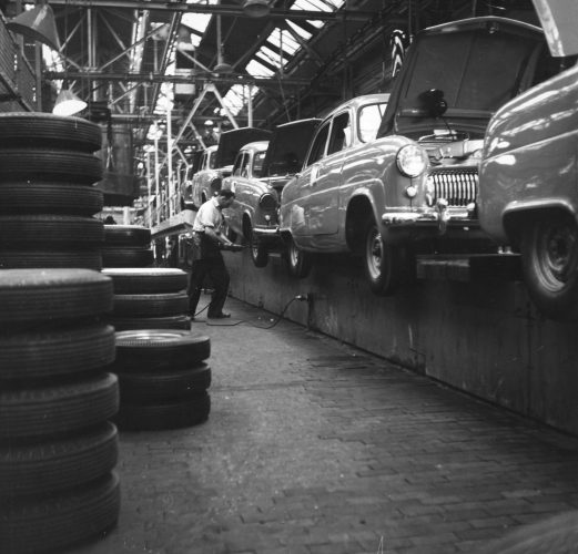 A worker on the production line at a Ford car factory in 1950