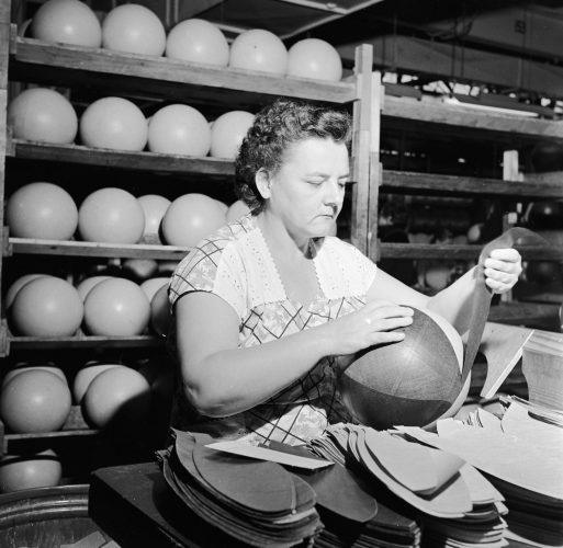 A worker prepares a basketball at the Spalding plant